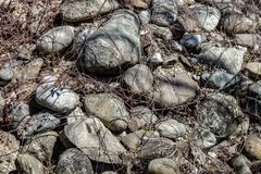 Background. photograph of piles of stone collected and used in building either whole or as crushed rock. Background. photograph of piles of stone collected and royalty free stock photography