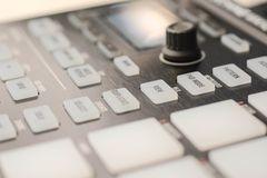 Buttons and pads on modern music machine. Background Photographed in macro, for the music industry or in the daily news for effect, on website for great royalty free stock photo