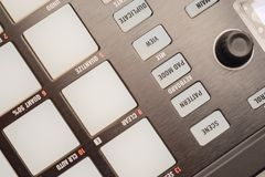 Buttons and pads on modern music machine. Background Photographed in macro, for the music industry or in the daily news for effect, on website for great royalty free stock photography