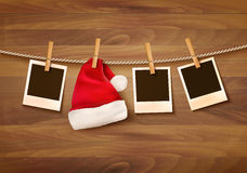 Background with photos and a santa hat. Stock Image