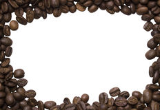 Background of photos spilled roasted Arabica coffee. Close-up shot with empty space  for text Royalty Free Stock Photo
