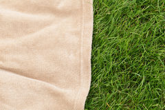 Background for a picnic - plaid on grass Royalty Free Stock Photography