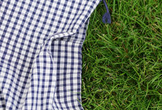 Background for a picnic - plaid on grass Stock Image