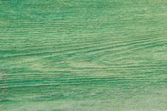The background picture of the old green wooden Board. Texture. Stock Image