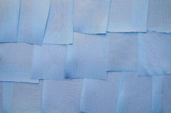 Background of the pieces of tape. Background from small pieces of satin ribbons blue Royalty Free Stock Photos