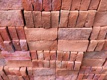 Pile of Neatly Arranged Construction Bricks. Background of Pile of Neatly Arranged Construction Bricks Royalty Free Stock Photography