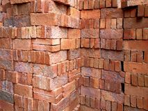 Pile of Neatly Arranged Construction Bricks. Background of Pile of Neatly Arranged Construction Bricks Stock Images