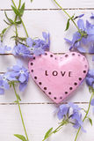 Background with pink decorative heart  and  fresh tender blue fl Stock Photo