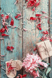 Background with pink peony, peonies petals, gift box and a woode Stock Images