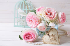 Background with  pink roses flowers  in blue vase and decorative Royalty Free Stock Images
