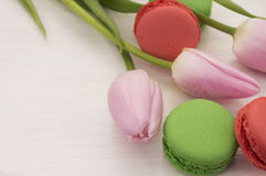 Background with pink tulips and macaroons. Royalty Free Stock Photos
