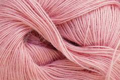 Background of a pink woolen thread for knitting close up. Background of a pink woolen thread for knitting Royalty Free Stock Photography