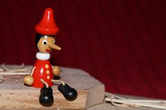 Pinochio wooden doll. Background with Pinochio wooden doll Royalty Free Stock Photos
