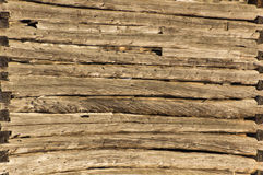 Background pioneer log cabin barn wall in sunshine Stock Image