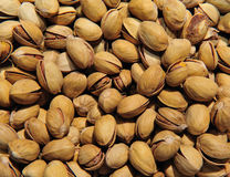 Background of pistachios. The image has a background of pistachios, could be used to represent the product and be used background or texture, to make this Royalty Free Stock Photos