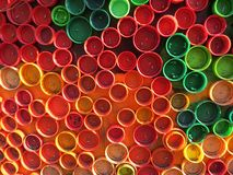 Background of plastic colorful bottle caps. Contamination with plastic waste. Environment and ecological balance. Art from junk. Background of plastiolorful stock photography