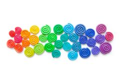 Background of plasticine. Twisted colored spirals of plastic of. Different colors stock images