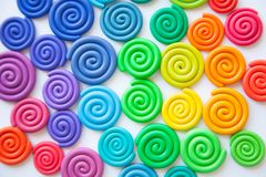 Background of plasticine. Twisted colored spirals of plastic of. Different colors royalty free stock photography