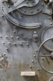 Background of plate metal, gears, and rivets Stock Images