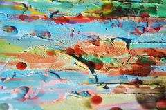 Background. Playful shapes, wax, paint, watercolor hues. Background. Playful shapes and forms in green, gray, red, orange and brown hues and colors. Abstract Stock Photo
