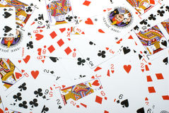 Background from playing cards. Background from the playing cards which have been spread out in a chaotic order Stock Photos