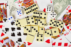 Background - playing cards, dice, money, dominoes. Background of playing cards, dice, money, and dominoes Royalty Free Stock Images