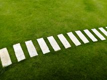 Background of Playing Field. Background of green grass playing field and white brick Royalty Free Stock Photography