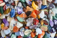 Background of polished colored gemstones royalty free stock photo