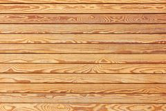 Background of polished hardwood boards with distinctive structure. Background of polished hardwood boards with a distinctive structure Stock Image