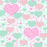 Background with Polka-Dot Hearts. Background filled with hearts of many sizes and shades of pink and green with polka-dots Stock Photography
