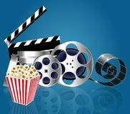 Background with popcorn and film strip with reflection Royalty Free Stock Images