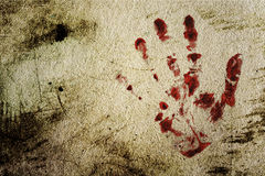 Background with a print of a bloody hand. Grunge background with a print of a bloody hand Stock Image