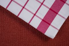 Background for product. Checked tablecloth in red and white cage on textured surface, view from above. Background for product. Checked tablecloth in a red and Stock Photos