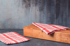 Background for product montage display with tablecloth and wooden board. Background for product montage display with checked tablecloth and wooden board royalty free stock image