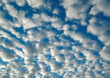 Background Puffy Clouds in Bright Blue Sky Royalty Free Stock Photography
