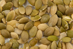 Background pumpkin seeds. Stock Photos