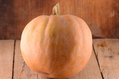 Background with pumpkin on wooden board Royalty Free Stock Photo