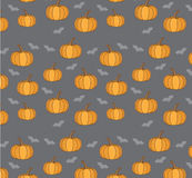 Background with pumpkins and bats for Halloween. Bright cartoon background with pumpkins and bats for Halloween Royalty Free Stock Image