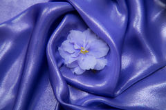 Background of purple, blue shiny fabric,  with violet Royalty Free Stock Photos