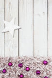 Background purple christmas balls and star Royalty Free Stock Photography
