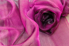 Background purple cloth folded in the shape of a rose Royalty Free Stock Photo