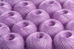 Background purple yarn. Texture of colored yarn skeins royalty free stock photo
