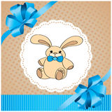 Background with rabbit and blue bow Royalty Free Stock Photo