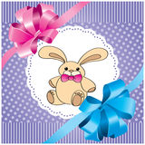 Background with rabbit and lilac bow Stock Images