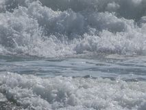 Background. Raging sea waves with foam and splashes. White and blue tones royalty free stock photo