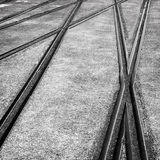 Background with railway crossing on gray asphalt. Abstract view. Transportation background with railway crossing on gray asphalt. Soft selective focus and Royalty Free Stock Photo