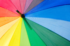 Background with Rainbow umbrella Stock Images