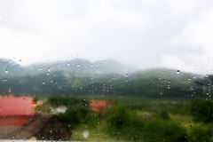 Background with rainy drops on window glass Stock Photos