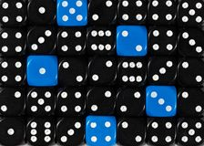 Background of random ordered black dices with five blue cubes. Pattern background of random ordered black dices with five blue cubes stock photography