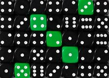 Background of random ordered black dices with five green cubes. Pattern background of random ordered black dices with five green cubes stock images